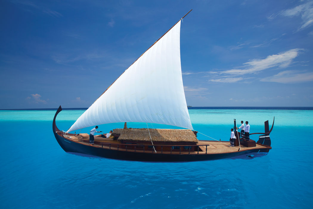 Couple riding dhoni in Maldives ocean